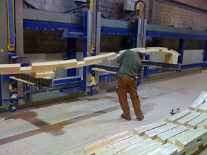Worker checking laminated beam