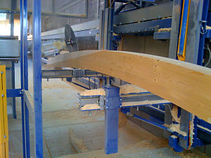 Wood gluelam beam being processed